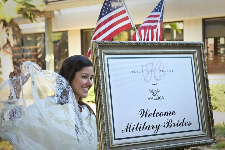 A bride collects her gown from a Brides Across America event at Brickhouse Bridal in Houston {source}
