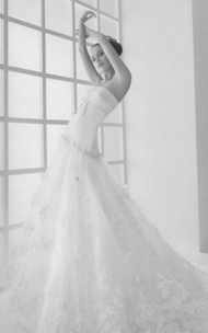 Rosa Clara Loren wedding dress for sale on PreOwnedWeddingDresses.com