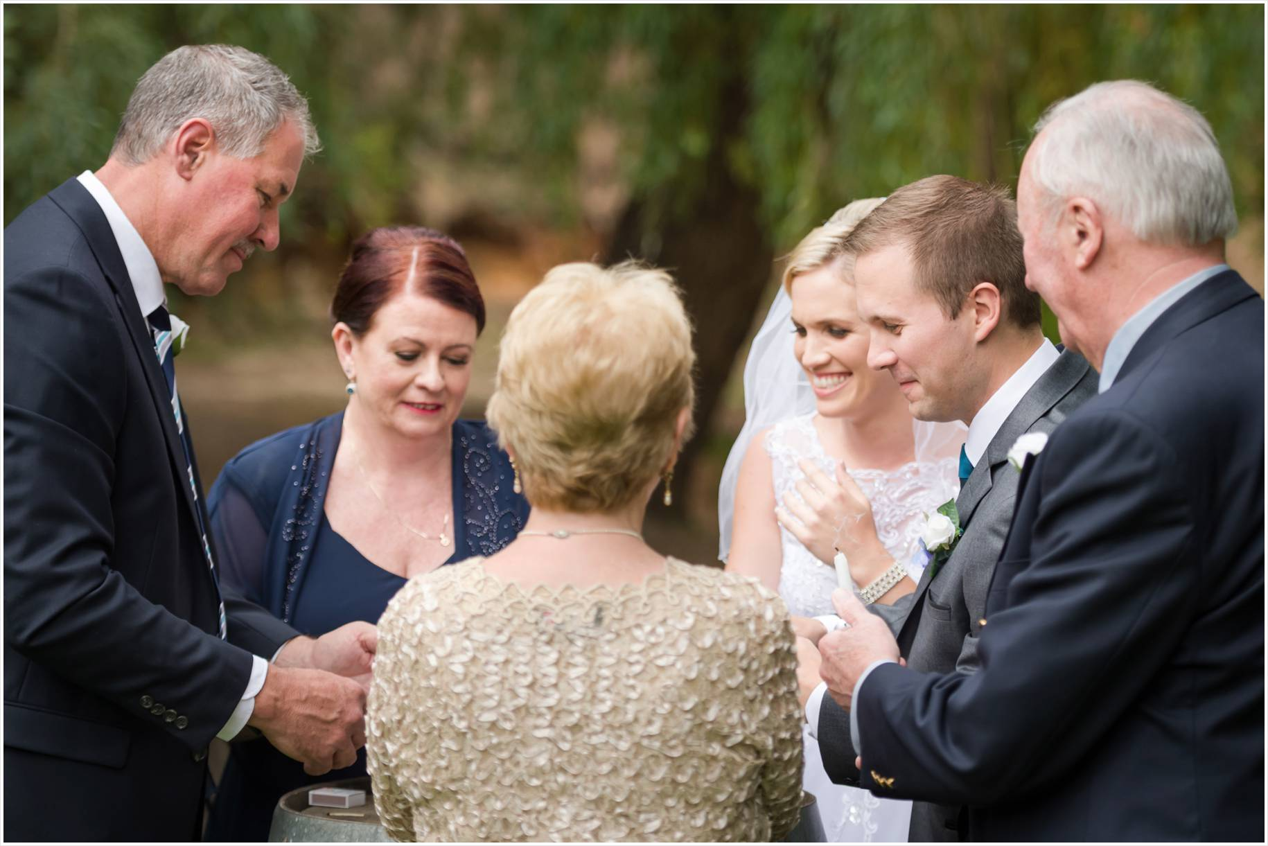Parents joining couple getting married