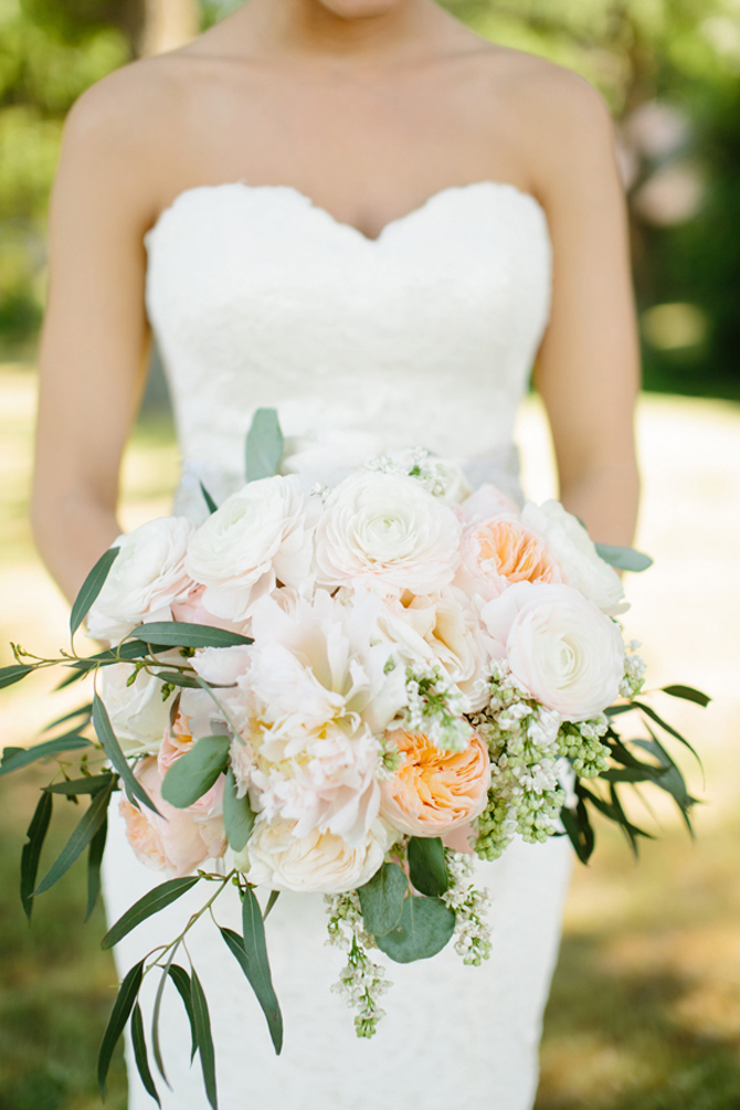 Bouquet with creams, whites, blushes, and peaches. Ranunculus, Juliet garden roses, peonies, white lilac, eucalyptus leaves, O'Hara garden roses, hydrangeas, and snapdragons. | Tucker Images http://www.tuckerimages.com/ - Southern Weddings Magazine. http://southernweddings.com/2014/05/29/blush-and-navy-texas-wedding-by-tucker-images/ La Tee Da Flowers http://www.lateedaflowers.com/