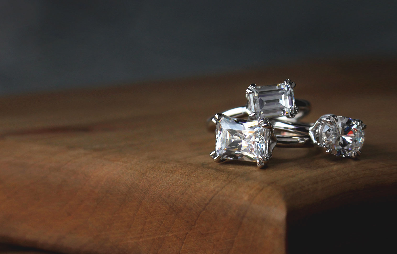 Three synthetic diamond rings with three different cuts
