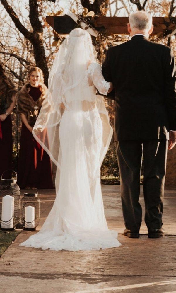 Bride wearing waterfall veil