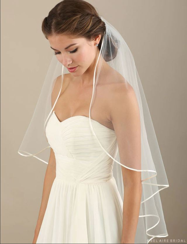 bride wearing ribbon edge veil