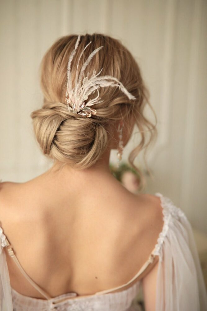 Bride wearing hair pin with feathers