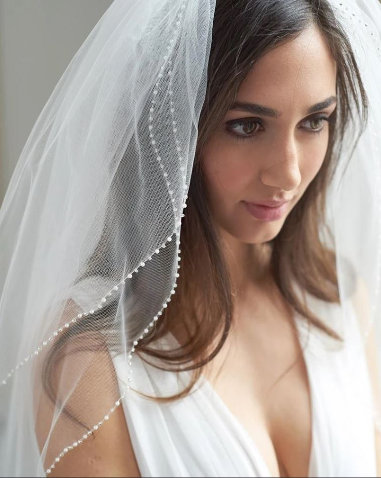bride wearing pearl edge veil