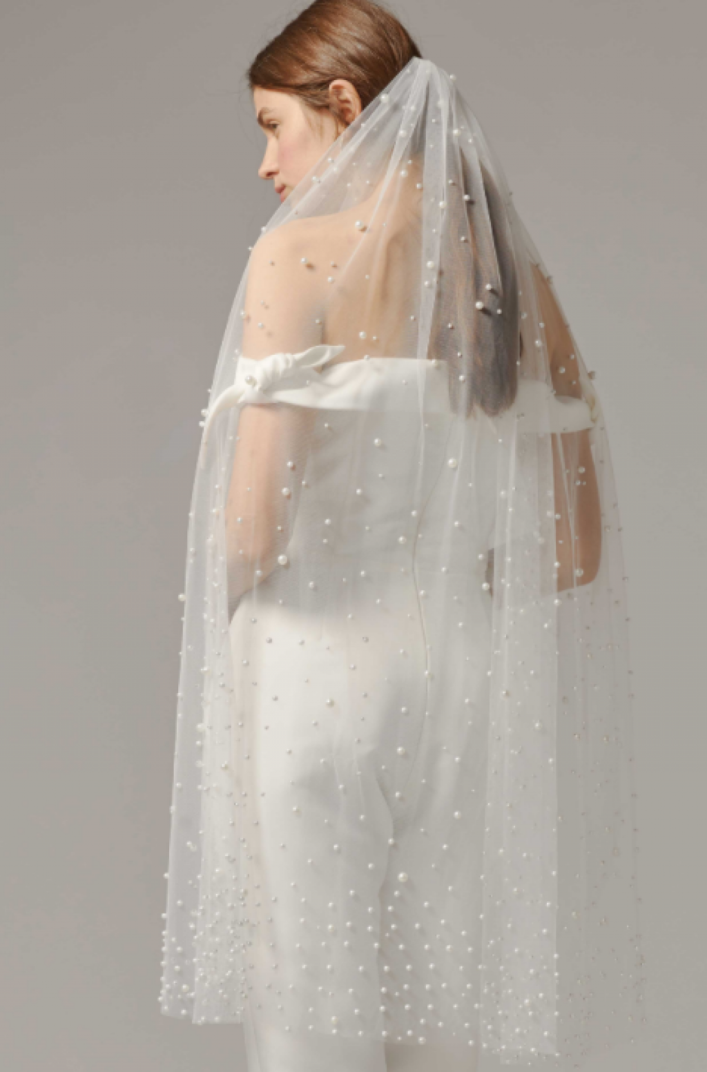 Bride wearing fingertip veil