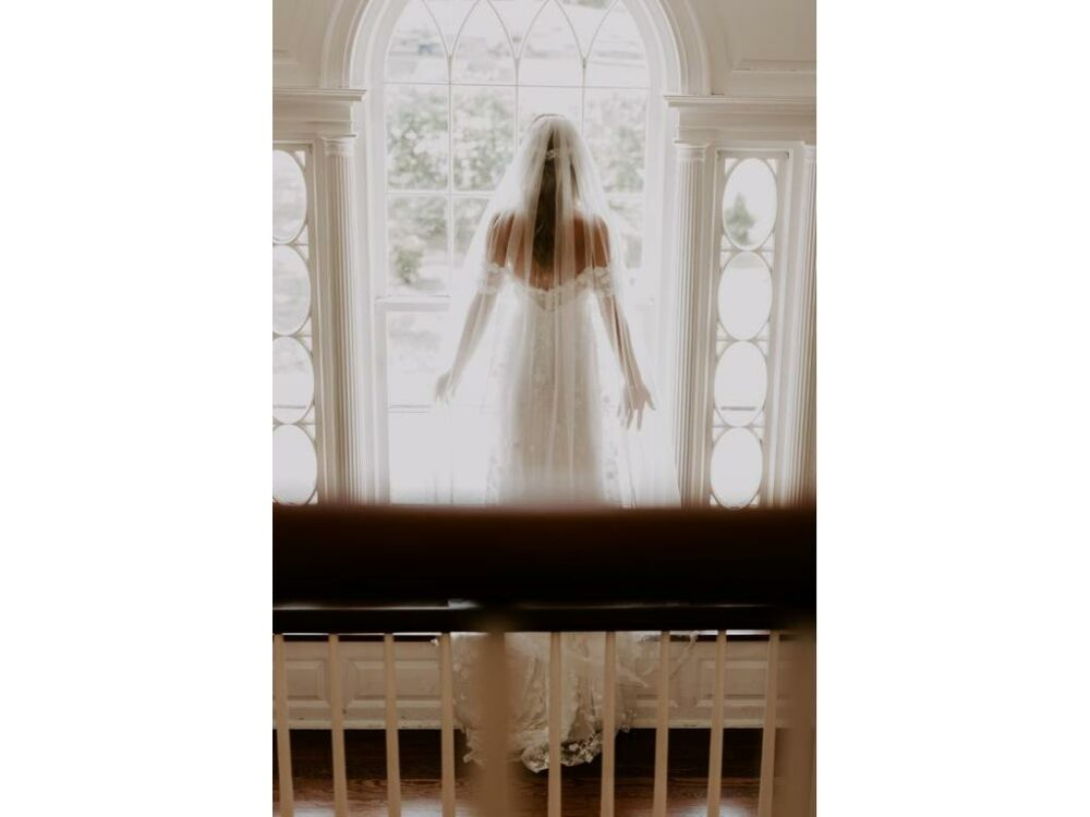 Bride wearing floor length veil