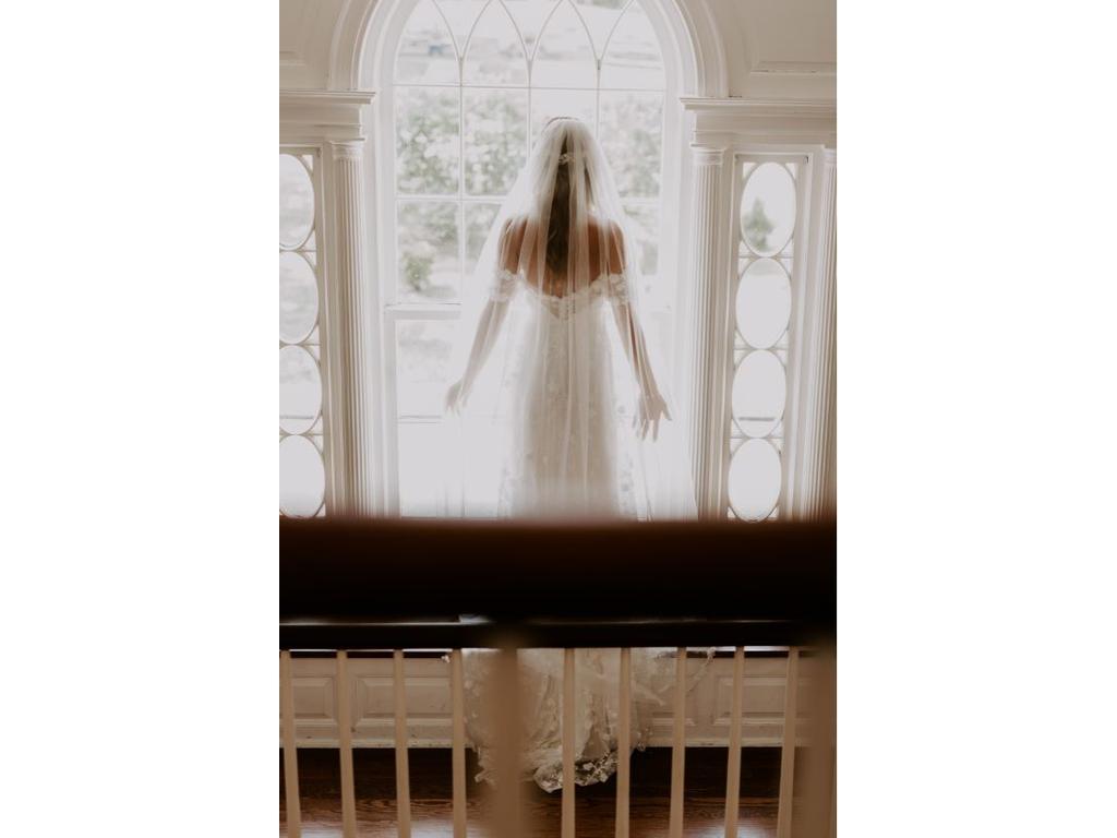 Bride wearing floor length veil