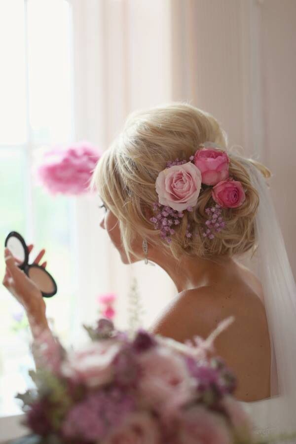 Bride wearing flowers in her hair