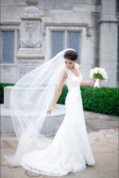 bride wearing raw edge veil