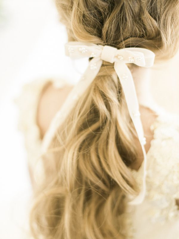 Bride wearing velvet bridal hair bow
