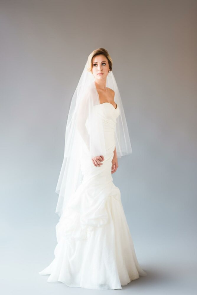 bride wearing knee length veil