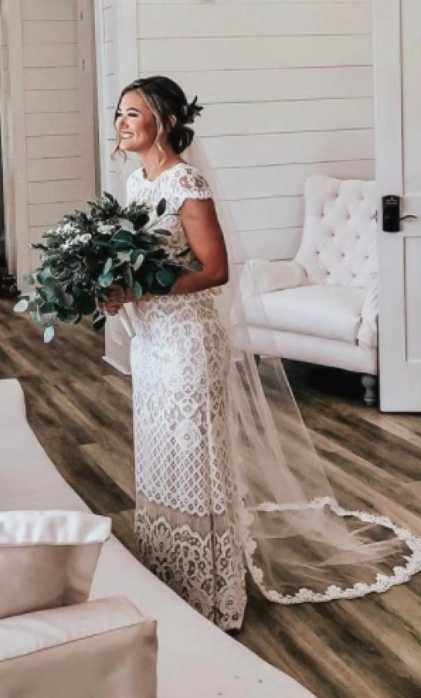 Bride wearing chapel length veil