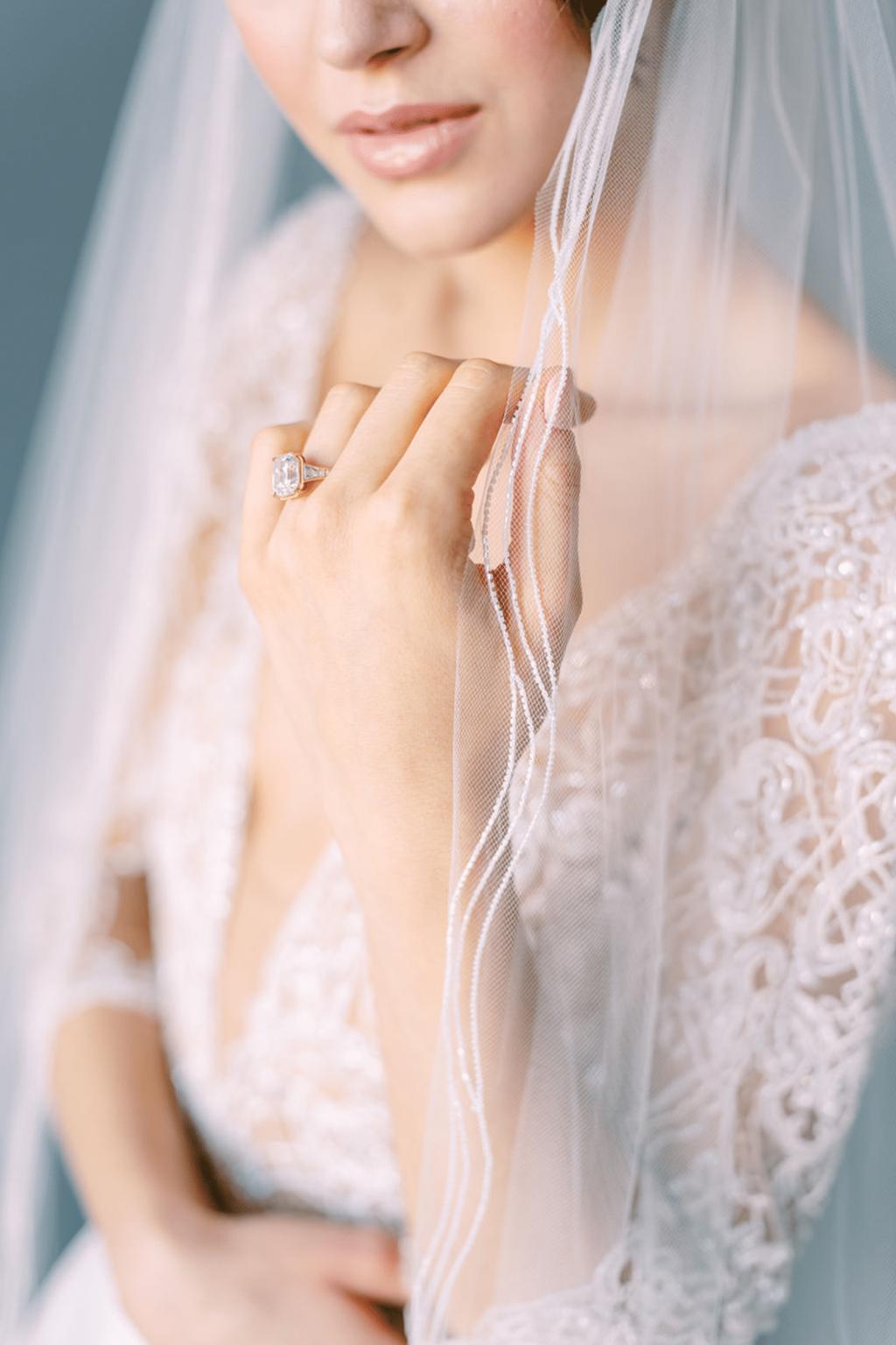 Bride wearing pencil edge veil