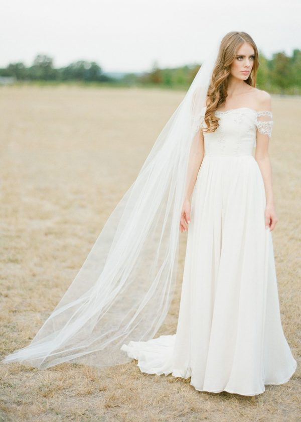 bride wearing cathedral length veil