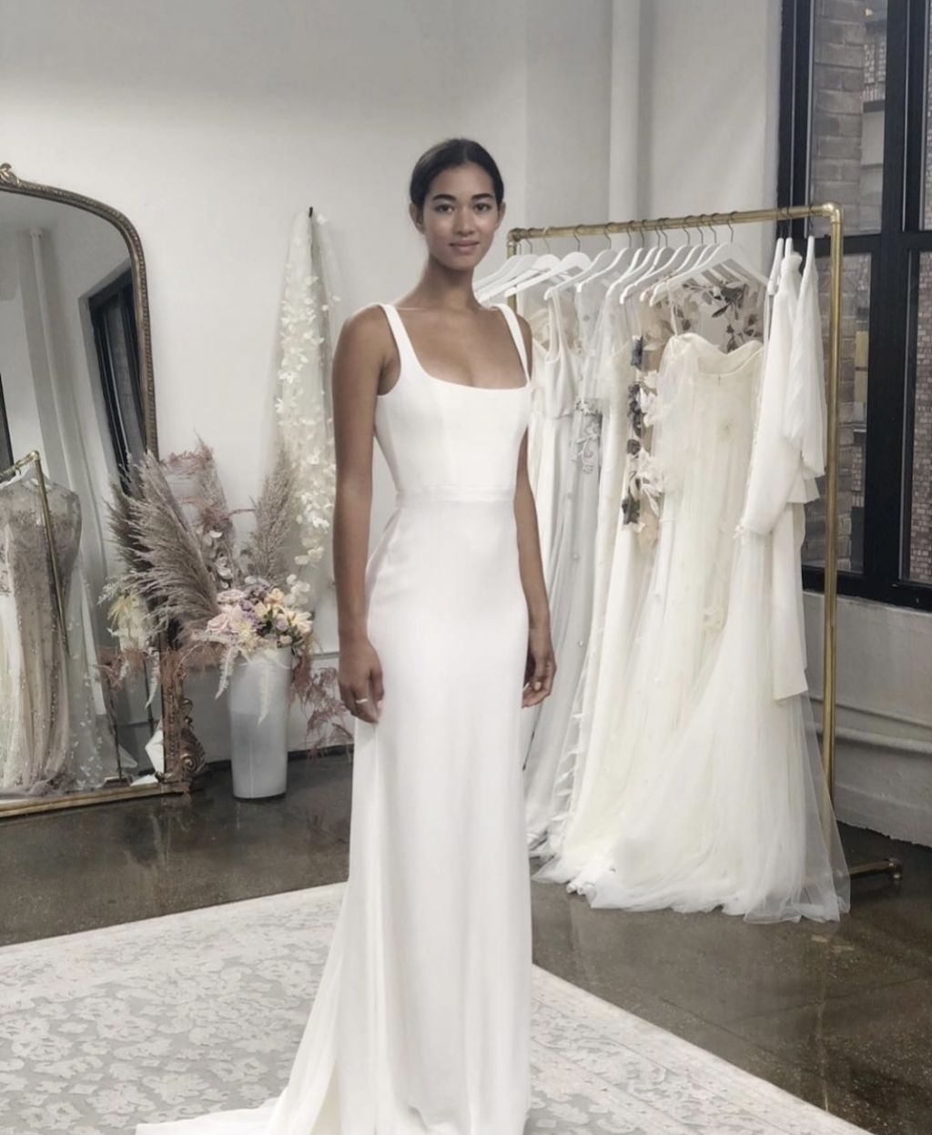 A simple sheath bridal gown with square neckline
