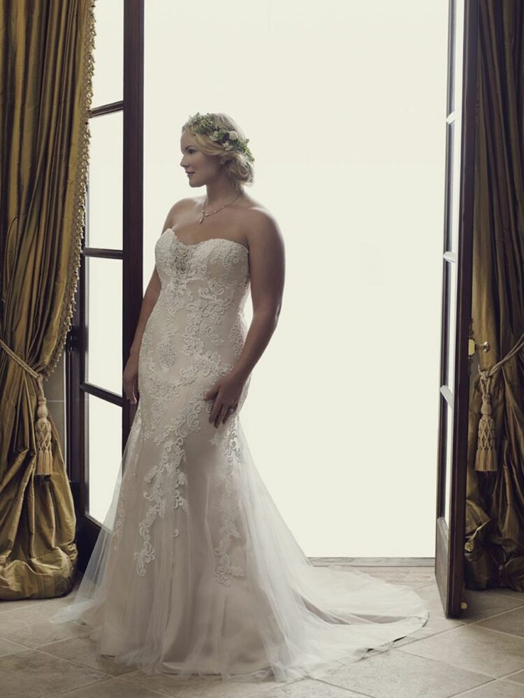 Plus size bride wearing fit-and-flare wedding dress - the Casablanca Lotus gown
