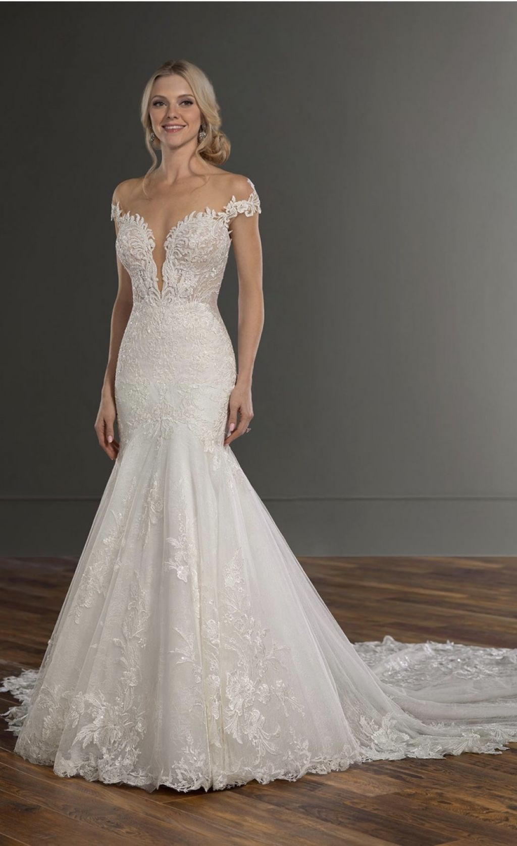 beautiful lace off-the-shoulder fit-and-flare bridal gown.