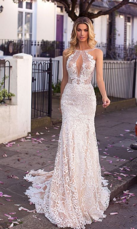 bride wearing stunning lace fit and flare gown by Milla Nova