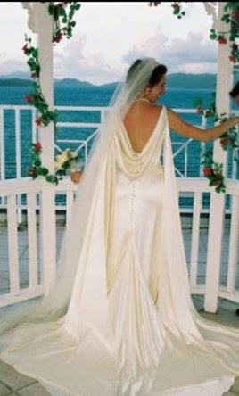 Bride wearing a slip wedding dress with cowl back