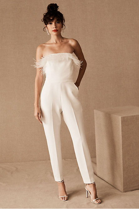 Fun & flirty wedding jumpsuit with feathers by BHLDN