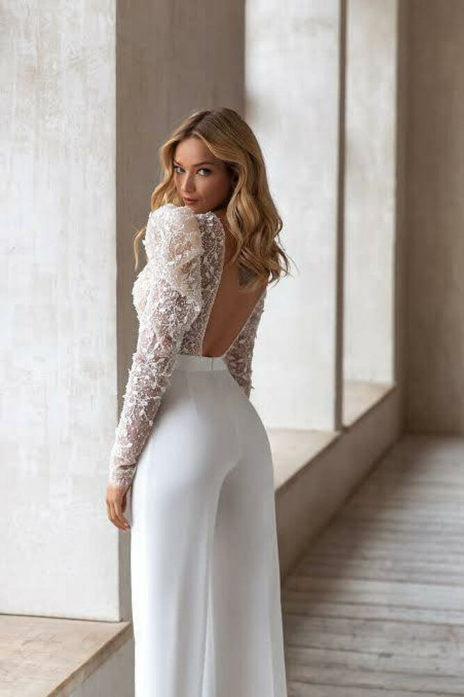 Glamorous bridal pantsuit with sheer bodice and long sleeves