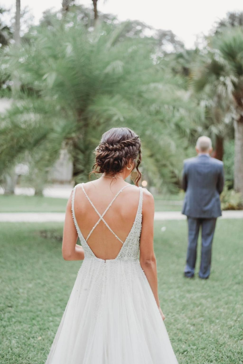 bride wearing Glamorous a-line wedding dress with criss-cross beaded back straps