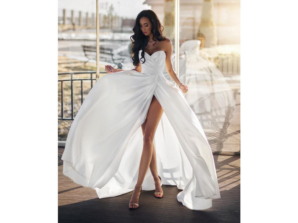 bride wearing simple A-line wedding dress with high-slit in skirt