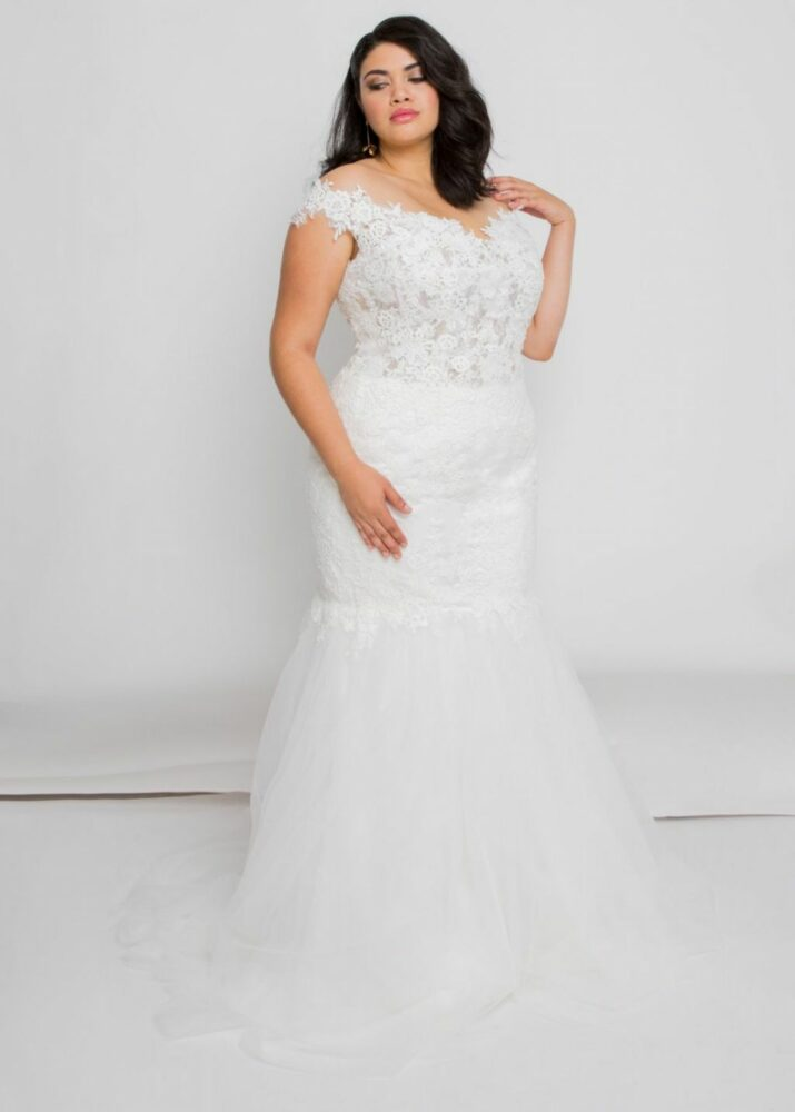 bride posing in Audie wedding dress by Leigh & Siena a beautiful plus size lace wedding dress