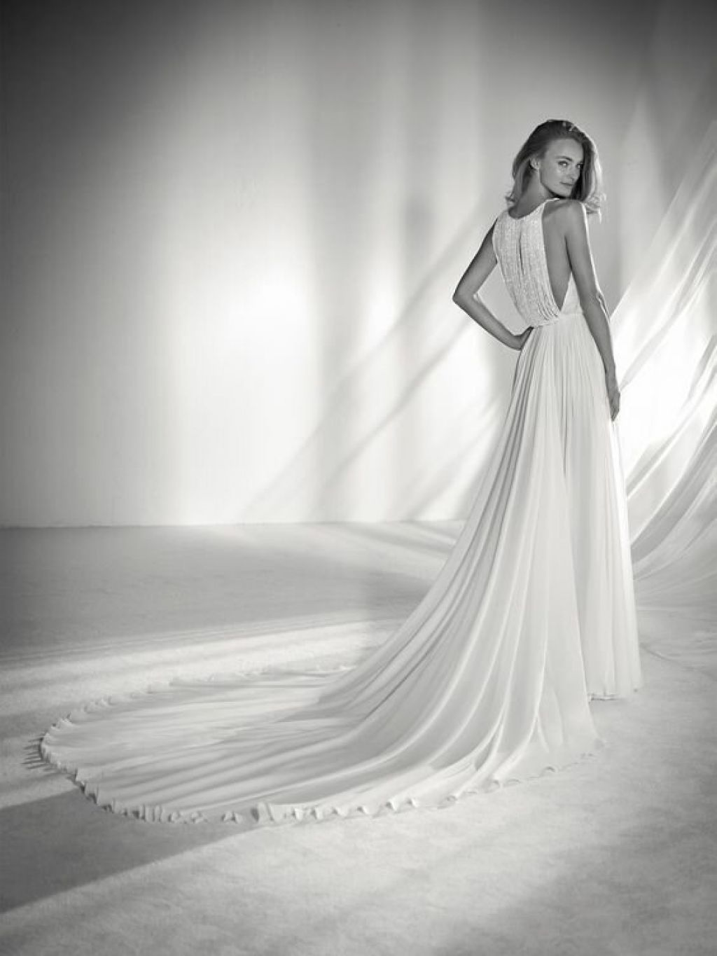 Ultra-glam soft A-line wedding dress with flowy skirt and beaded fringe bodice by Pronovias