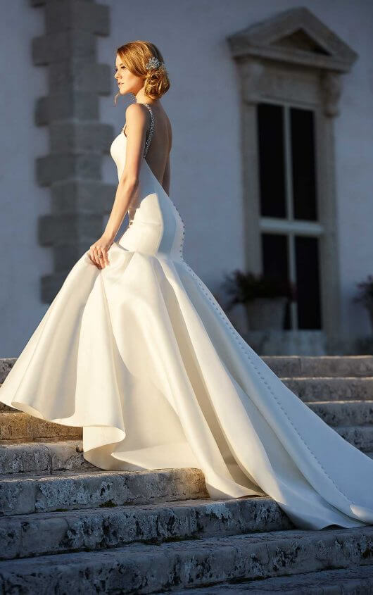 Bride on stairs wearing Martina Liana 735 a high-fashion glamorous trumpet wedding gown