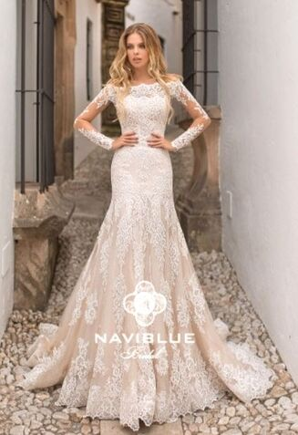 Bride wearing Naviblue Jacquelyn with detachable lace bolero