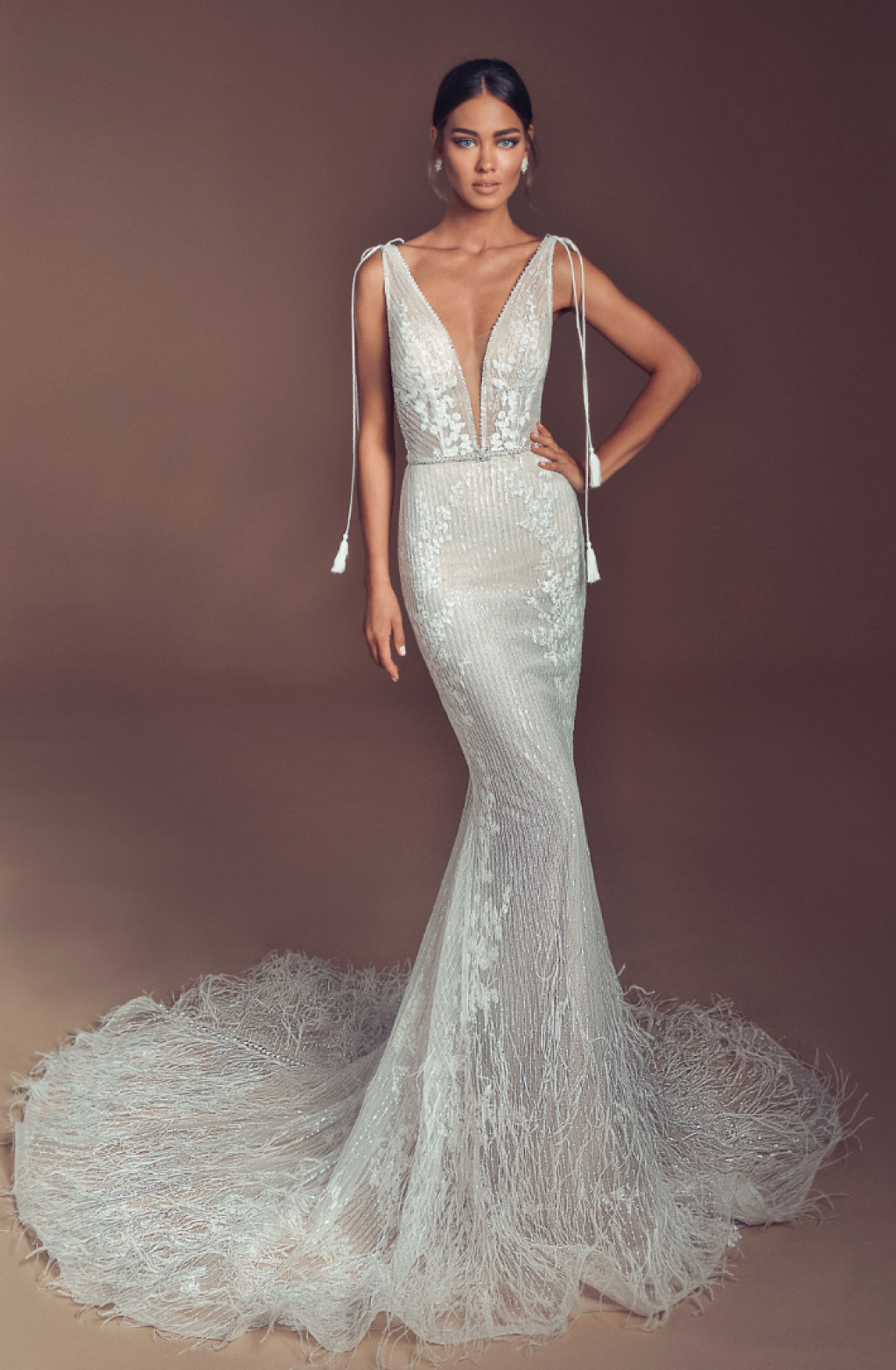 Couture mermaid wedding dress with ostrich feather skirt and train