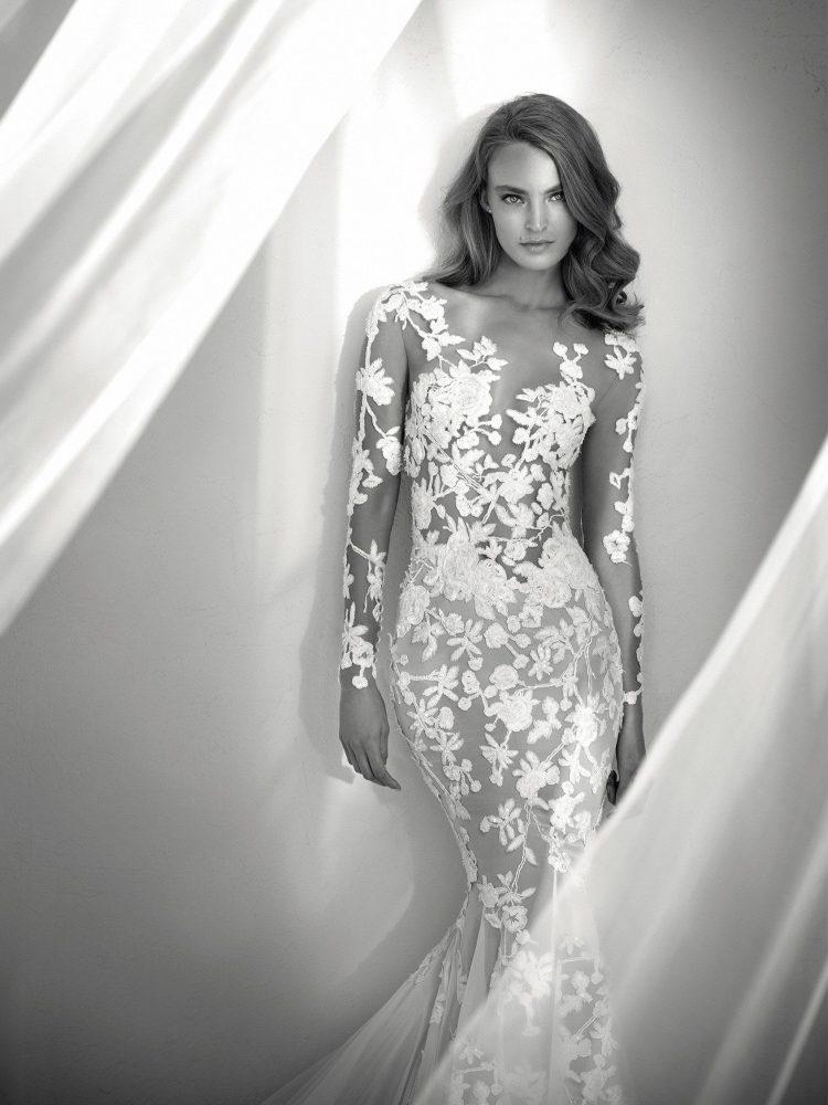 bride wearing long sleeve lace mermaid wedding dress by Pronovias