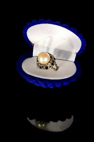 Pearl ring in shaped box